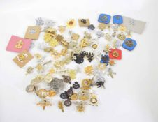 Quantity of military cap badges varying crowns and dates and regiments to include Blues & Royals,