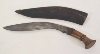 20th century Nepalese Kukri with wooden handled grip and steel plated pommel, in worn leather