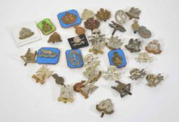 Mixed quantity of military cap badges, varying crowns and dates to include Royal Scots Greys,