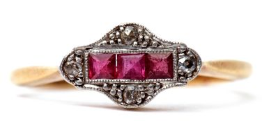Ruby and diamond ring, the centre featuring a line of three calibre cut rubies, framed in a