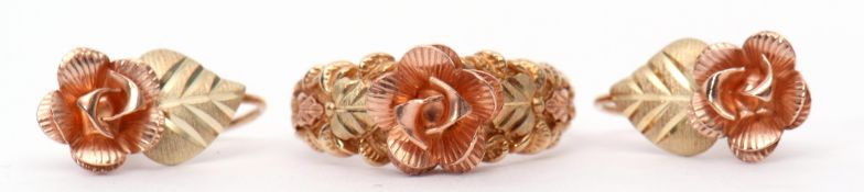 Mixed Lot: a tri-coloured ring of a raised flowerhead design between foliate cast engraved