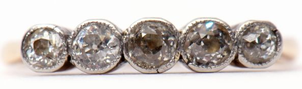 Five-stone diamond ring, each individually bezel set, stamped 18c, size O