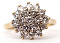 Diamond cluster ring, a design of two tiers of small round brilliant cut diamonds (19) stamped 18ct,