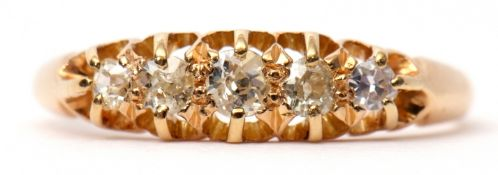 Yellow metal graduated five-stone diamond ring, the 5 old cut diamonds claw set in a carved gallery,