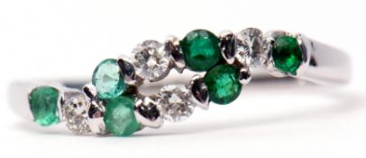 Modern precious metal diamond and emerald ring, alternate entwined design featuring 4 small