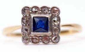 Art Deco sapphire and diamond cluster ring, the square cut cushion shape sapphire raised within a