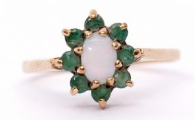 Modern 9ct gold opalescent and emerald cluster ring, the oval cabochon centre opalescent within a