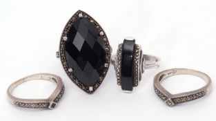 Mixed Lot: four 925 stamped rings, two with black onyx panels, highlighted with marcasite,