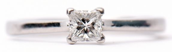 Single stone diamond ring, a princess cut diamond 0.34ct approx, prong set and raised between
