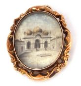 Antique double sided glazed oval pendant brooch, one side depicting an Indian temple, the verso a