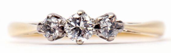 Three-stone diamond ring featuring 3 graduated brilliant cut diamonds, raised in upswept