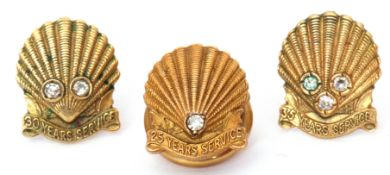 Mixed Lot: 9ct gold Shell Long Service (25 years) presentation buttonhole badge, highlighted with