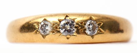 18ct gold and three stone diamond ring, featuring three small graduated brilliant cut diamonds, each