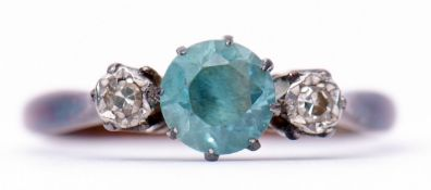 Blue zircon and diamond ring, a centre stone set between two small single cut diamonds, stamped