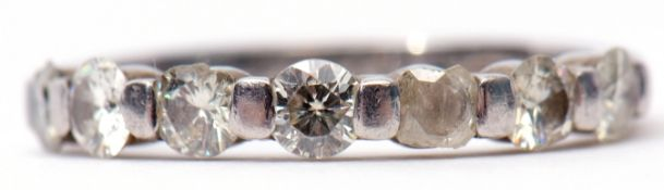 Precious metal 7-stone diamond ring, line set with 7 small diamonds (5 with chips/losses), stamped