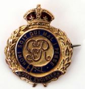 Royal Engineers badge, the centre with the George V crest within a blue enamel script, beneath a red