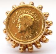 Iran gold half Pahlavi coin ring, the coin set in an ornate pierced bead basket mount to a split