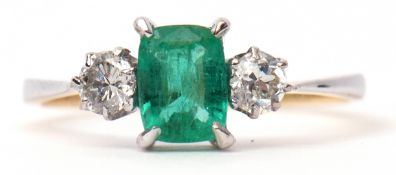 Diamond and emerald three stone ring, rectangular cut emerald flanked by two brilliant cut diamonds,