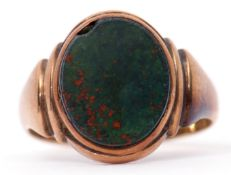 Antique gent's 9ct gold bloodstone set signet ring, the oval shaped panel framed and raised