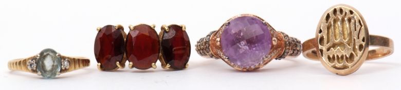 Mixed Lot: modern amethyst and diamond dress ring, stamped 14K, a modern 750 stamped three stone