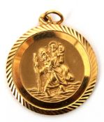 9ct gold circular shaped St Christopher pendant, 2.5cm diam, 8gms