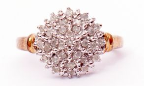 Modern diamond and cluster ring, a circular shaped panel set with small single cut diamonds, total