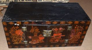 Modern Oriental cupboard in the form of a trunk with Chinese decoration to front panel and doors,