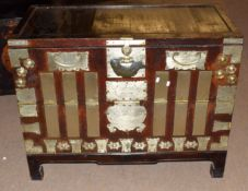 20th century hardwood Oriental trunk with brass and metalwork design and hinges, 99cm wide