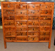20th century Chinese medicine cabinet, 28 drawers decorated with Chinese inscriptions, 132cm wide