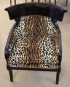 Pair of modern designer tub chairs in leopard print upholstery (2)