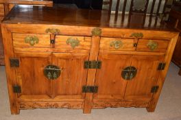 Modern Chinese style sideboard with four drawers over four doors, 145cm wide
