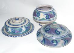 Three pieces of mid-20th century Poole Pottery vases decorated in tones of blue and green with a