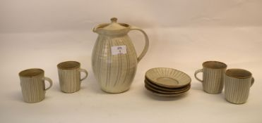 Yelland Pottery part coffee set comprising four coffee cans and saucers and a jug and cover, all