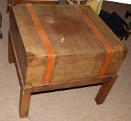 Modern designer side table with drawer, modelled as a leather travelling trunk on stand, 66cm wide