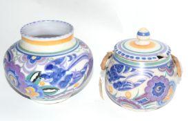 One mid-20th century Poole Pottery vase, and a jam pot and cover, pot with wicker handle, both