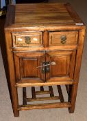 20th century Chinese style hardwood bedside table, two drawers over two doors, 50cm wide