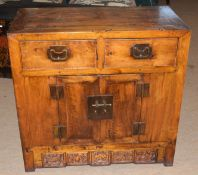 20th century Arts & Crafts style cabinet with two drawers over two doors, 87cm wide