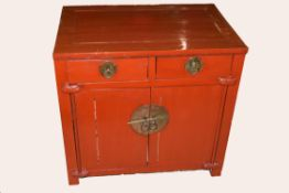 20th century Chinese style hardwood cupboard, two drawers over two doors, painted red, 77cm wide x