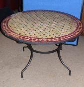 Modern Spanish mosaic tile top circular table on iron splayed feet, 120cm diam
