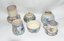 Group of mid-20th century Poole Pottery wares including a pot and cover, jar and cover, jug and