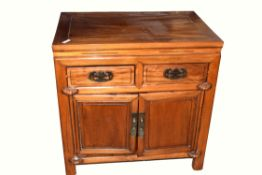 20th century small cupboard with two drawers over two doors in a Chinese style, 80cm wide