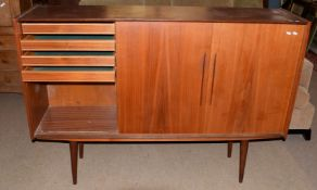 Mid-century teak cabinet with three sliding doors, the left hand side fitted with four drawers,