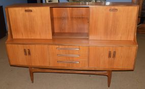 Mid-century teak G-plan sideboard, three drawers to centre, flanked by two twin door cupboards,