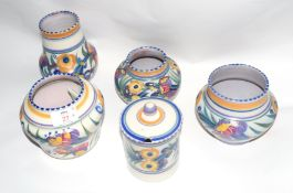 Group of four Poole Pottery Studio vases, all with floral designs by Truda Carter, largest 17cm high