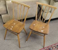 Early pair of Ercol mid-century teak kitchen chairs, (2)