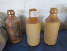 THREE SALT GLAZED STONEWARE BOTTLES INCLUDING STEWARD & PATTESON, NORWICH AND SWAFFHAM AND TWO