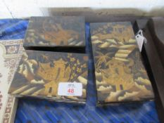 THREE SMALL ORIENTAL WOODEN TRINKET BOXES, EACH WITH PAINTED DECORATION ON A JAPANNED GROUND,