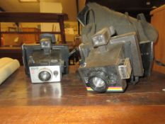TWO 1960S POLAROID CAMERAS, SQUARE SHOOTER II AND INSTANT 10