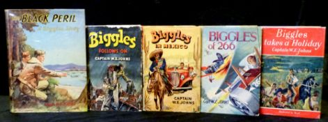 W E JOHNS: 5 titles: BIGGLES TAKES A HOLIDAY, 1949, 1st edition, original cloth, dust wrapper;