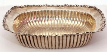 Late 19th century white metal shallow table dish of rectangular form, with scroll rim and ribbed